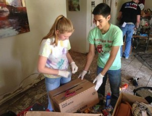 An online ministry of First United Methodist Church in San Marcos, Texas, helped recruit and organize volunteers to help with flood relief there. Students from San Marcos High School and Texas State University removed items from a flooded home in San Marcos' Blanco Garden area
