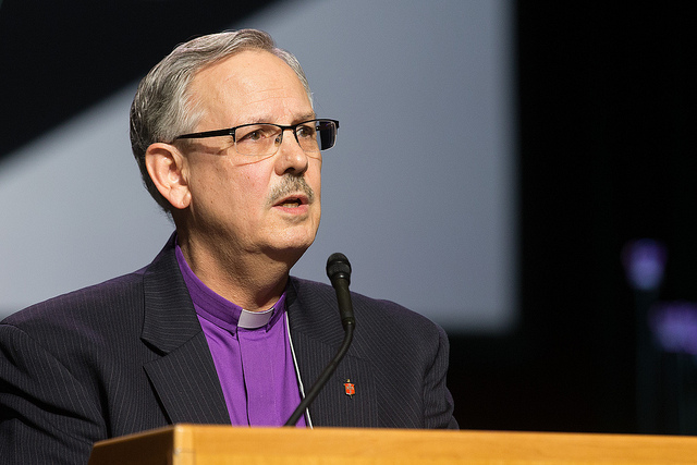 Bishop Bruce R. Ough, president of the United Methodist Council of Bishops, addresses the 2016 United Methodist General Conference May 17 in Portland, Ore., responding to social media posts claiming the church's bishops are calling for a special General Conference in to discuss a possible split. Ough emphasized the bishops remain committed to the unity of the denomination. Photo by Mike DuBose, UMNS
