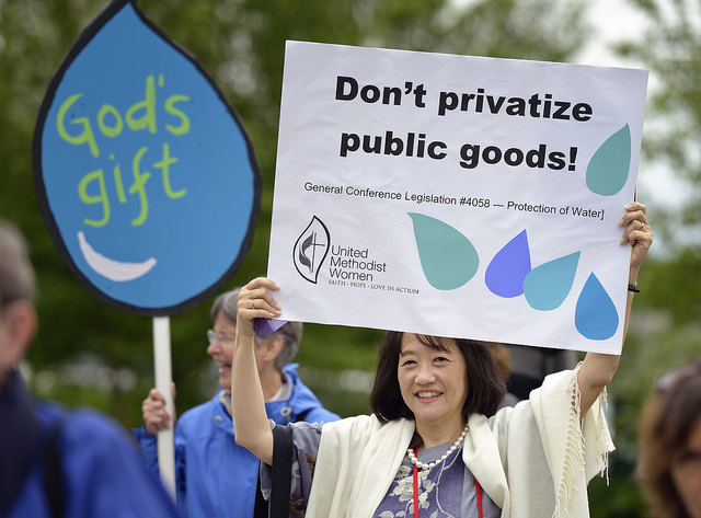 Hikari Chang holds a sign during a May 16 vigil for environmental justice at the 2016 United Methodist General Conference in Portland, Ore. Sponsored by United Methodist Women, the vigil focused especially on struggles for clean water around the world. Chang is a regional missionary based in Japan. Photo by Paul Jeffrey, UMNS.