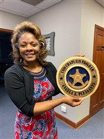 Rev. Angela Pleasants holding USSS seal